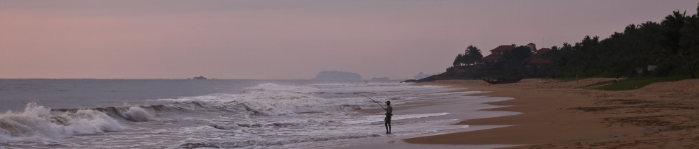 Fisherman at sunset on the beach at the Temple Tree Resort and S